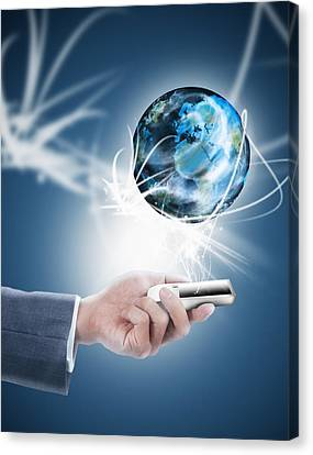 Businessman Holding Mobile Phone With Globe Canvas Print