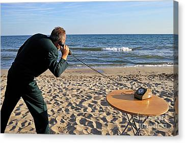 Businessman On Beach With Landline Phone Canvas Print by Sami Sarkis