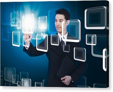 Selecting Canvas Print - Businessman Pressing Touchscreen by Setsiri Silapasuwanchai