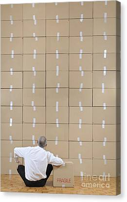 Businessman Seated Facing Cardboard Boxes Wall Canvas Print by Sami Sarkis