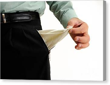 Businessman Showing Out An Empty Pant's Pocket Canvas Print