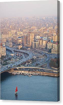 Busy Junction And The Nile With Traditional Boat Canvas Print by Kokoroimages.com