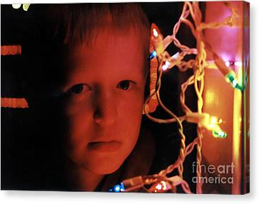 By The Glow Of Christmas Lights Canvas Print
