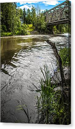 By The River Canvas Print by Matti Ollikainen