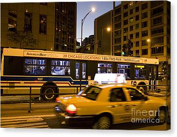 Cab And Bus Speeding On Michigan Avenue Canvas Print by Christopher Purcell