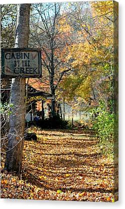 Canvas Print featuring the photograph Cabin By The Creek by Laurinda Bowling