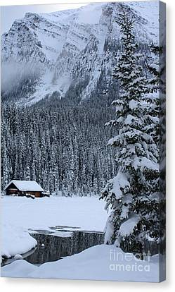 Cabin In The Snow Canvas Print by Alyce Taylor