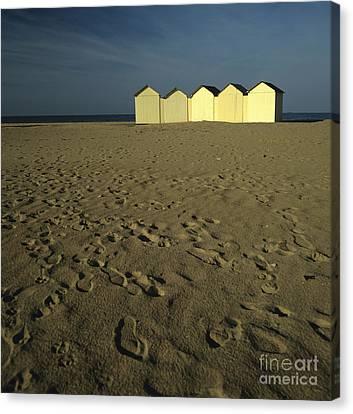 Cabins On A Beach In Normandy Canvas Print by Bernard Jaubert