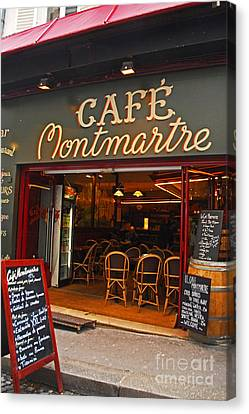 Cafe Montmartre Canvas Print by Bob and Nancy Kendrick