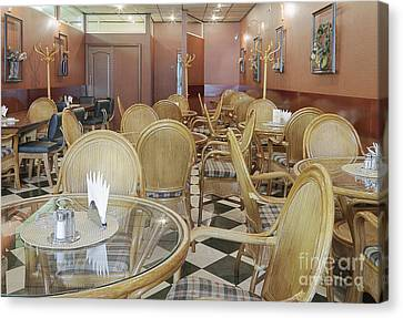 Cafe With Rattan Chairs And Tables Canvas Print