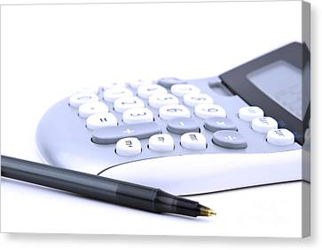 Calculator And Pen Canvas Print by Blink Images