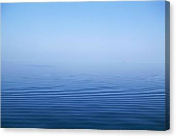 Calm Blue Water Disappearing Into Canvas Print by Axiom Photographic