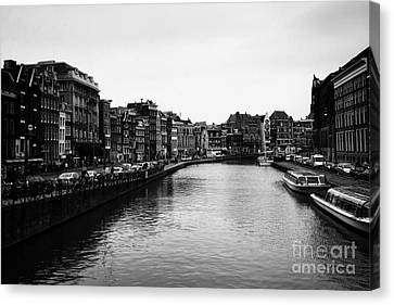 Canals Of Amsterdam Canvas Print by Leslie Leda