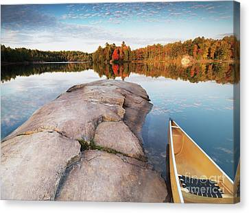 Canoe At A Rocky Shore Autumn Nature Scenery Canvas Print by Oleksiy Maksymenko