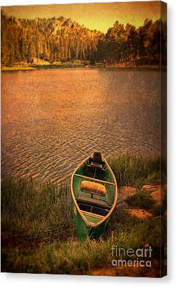 Canoe On Lake Canvas Print by Jill Battaglia