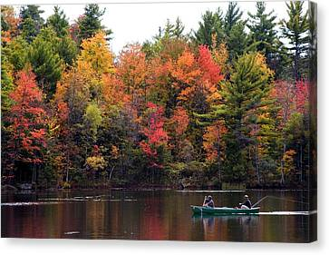 Canoeing In Autumn Canvas Print