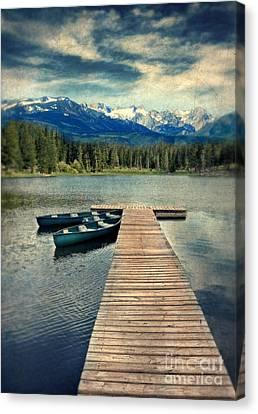 Canoes At Dock On Mountain Lake Canvas Print by Jill Battaglia