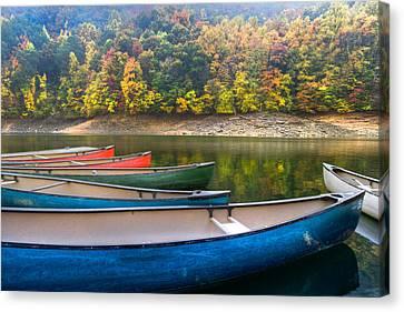 Canoes At Fontana Canvas Print by Debra and Dave Vanderlaan