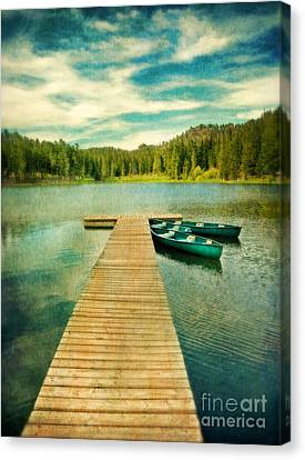 Canoes At The End Of The Dock Canvas Print by Jill Battaglia