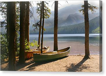 Canoes At The Ready Canvas Print by Marty Koch