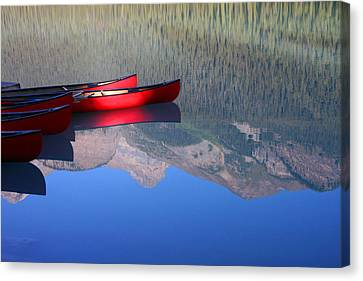 Canoes In The Rockies Canvas Print by Steve Parr