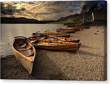 Canoes On The Shore, Keswick, Cumbria Canvas Print by John Short