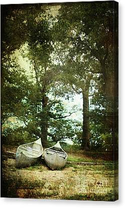 Canoes On The Shore Canvas Print by Stephanie Frey