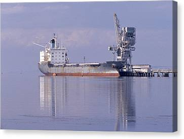 Cargo Tanker Ship Tied Up To A Jetty Canvas Print by Jason Edwards