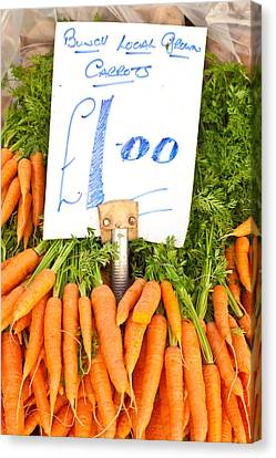 Carrots Canvas Print by Tom Gowanlock