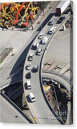 Cars On An Exit Ramp Canvas Print by Don Mason