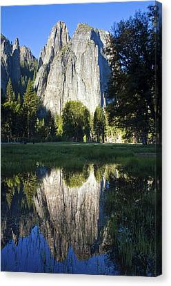 Cathedral Rocks Are Reflected In A Pool Of Water In Yosemite National Park, Ca Canvas Print