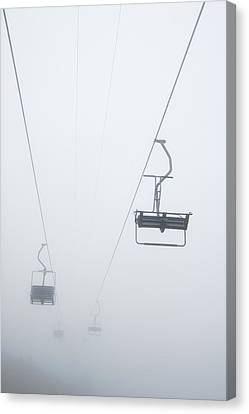 Chairlift In The Fog Canvas Print by Matthias Hauser