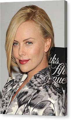 Charlize Theron At In-store Appearance Canvas Print by Everett