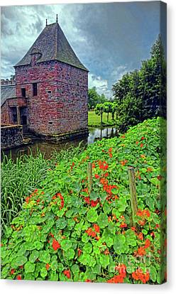 Canvas Print featuring the photograph Chateau Tower And Nasturtiums by Dave Mills