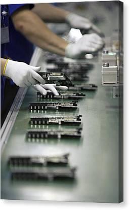 Checking Tv Circuit Board Components Canvas Print by Ria Novosti