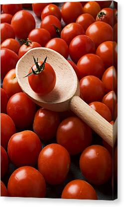 Cherry Tomatoes And Wooden Spoon Canvas Print by Garry Gay