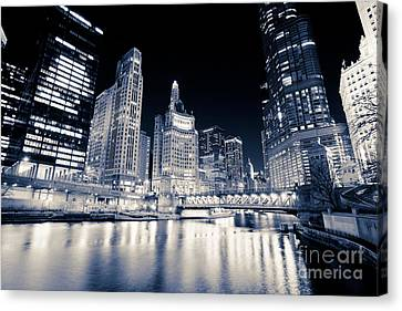Chicago At Night At Michigan Avenue Bridge Canvas Print by Paul Velgos