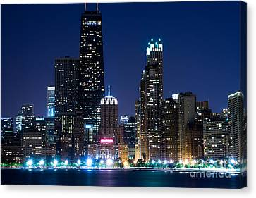 Chicago Skyline At Night With John Hancock Building Canvas Print by Paul Velgos