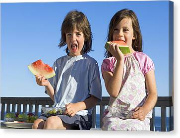 Children Eating Watermelon Canvas Print by Lawrence Lawry
