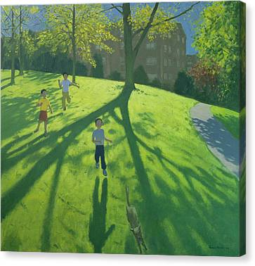 Children Running In The Park Canvas Print by Andrew Macara