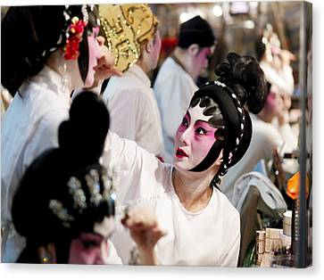 Chinese Opera Performers Prepare Canvas Print by Justin Guariglia