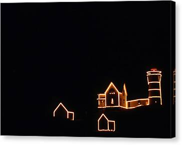 Christmas At The Nubble Canvas Print by Skip Willits