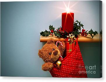 Holly Berry Still Life Canvas Print - Christmas Stocking Filled With Presents With Candle And Holly. by Richard Thomas
