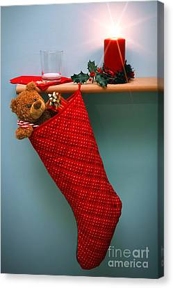 Holly Berry Still Life Canvas Print - Christmas Stocking Filled With Presents With Empty Milk Glass.  by Richard Thomas