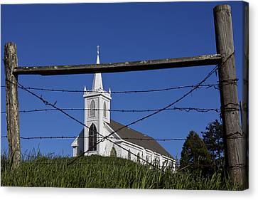 Church And Barbed Wire Canvas Print by Garry Gay