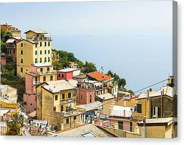 Cinque Terre - Riomaggiore Canvas Print by Michal Krakowiak