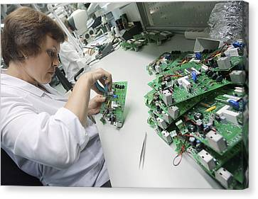 Electronic Component Canvas Print - Circuit Board Assembly Work by Ria Novosti