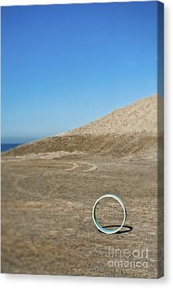 Circular Object On Beach Canvas Print by Eddy Joaquim