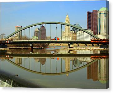 City Reflections Through A Bridge Canvas Print by Laurel Talabere