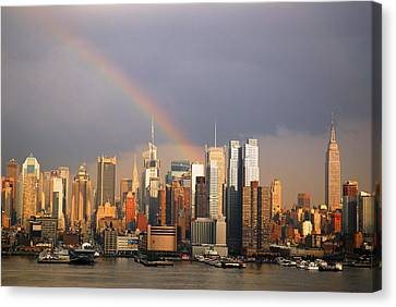 Clearing Skies Over Manhattan Canvas Print by James Kirkikis